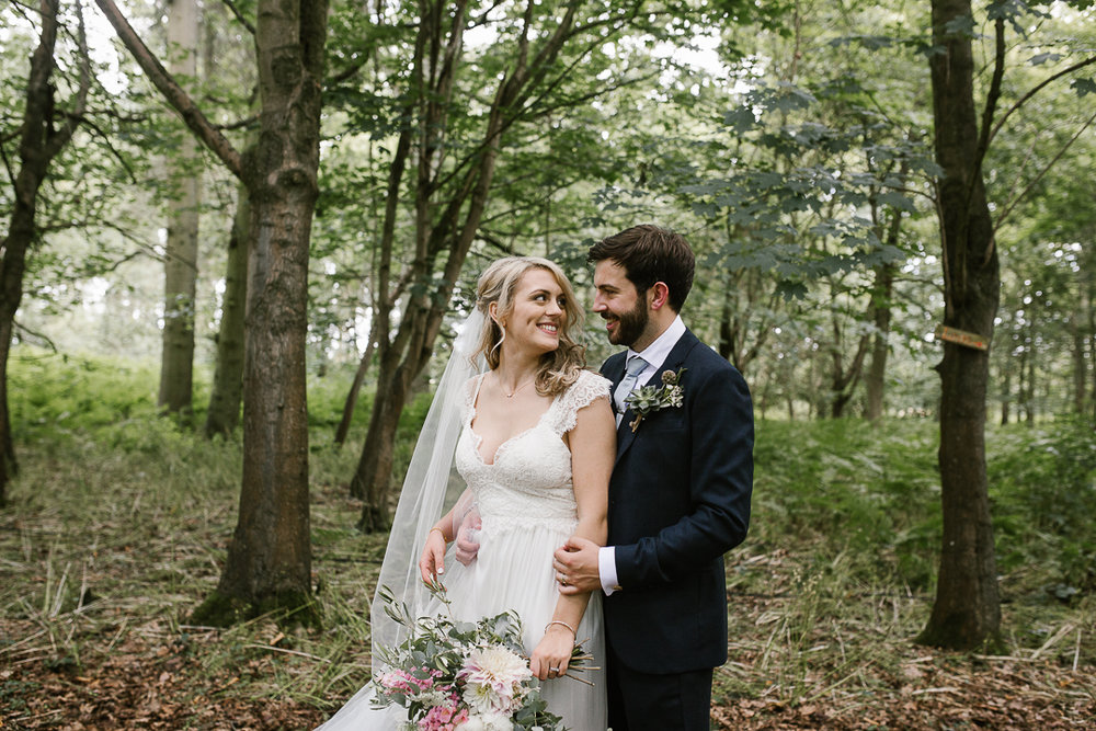 natural photo of bride and groom in the woodlands at Wildwood Bluebell after their outdoor ceremony