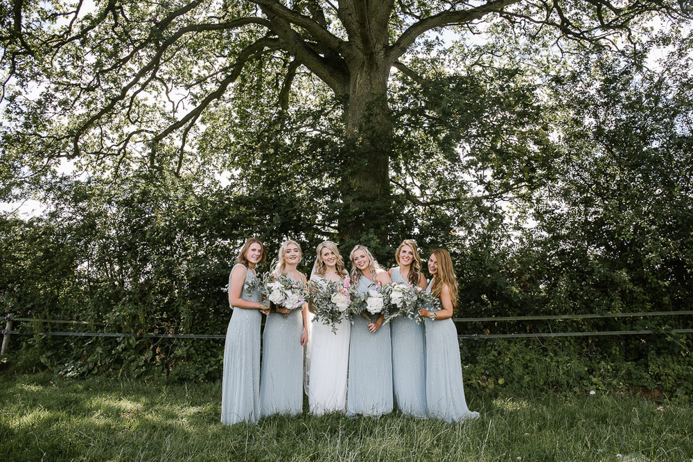 happy photo of bridesmaids wearing asos bridesmaids dresses