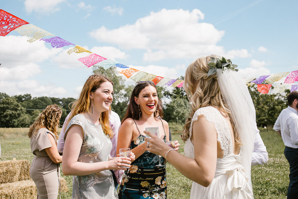 candid photo of summer wedding of guests laughing