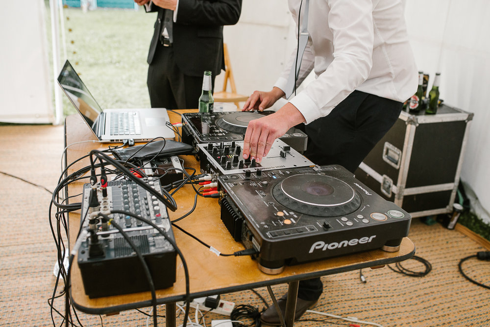 close up photo of the dj set at festival wedding