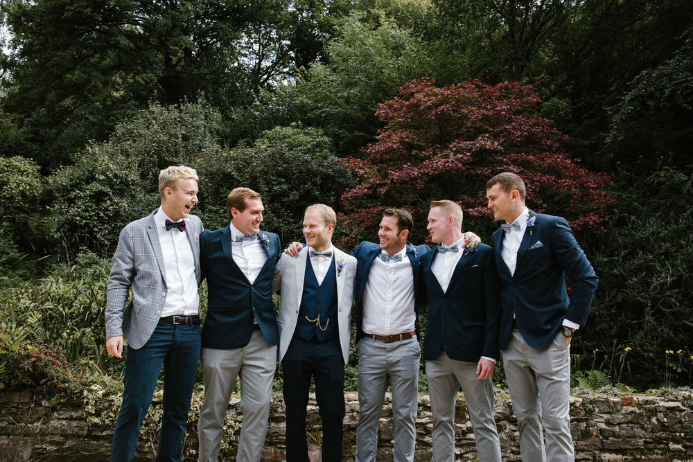 natural photo of groom and groomsmen on the morning of his outdoor tipi wedding