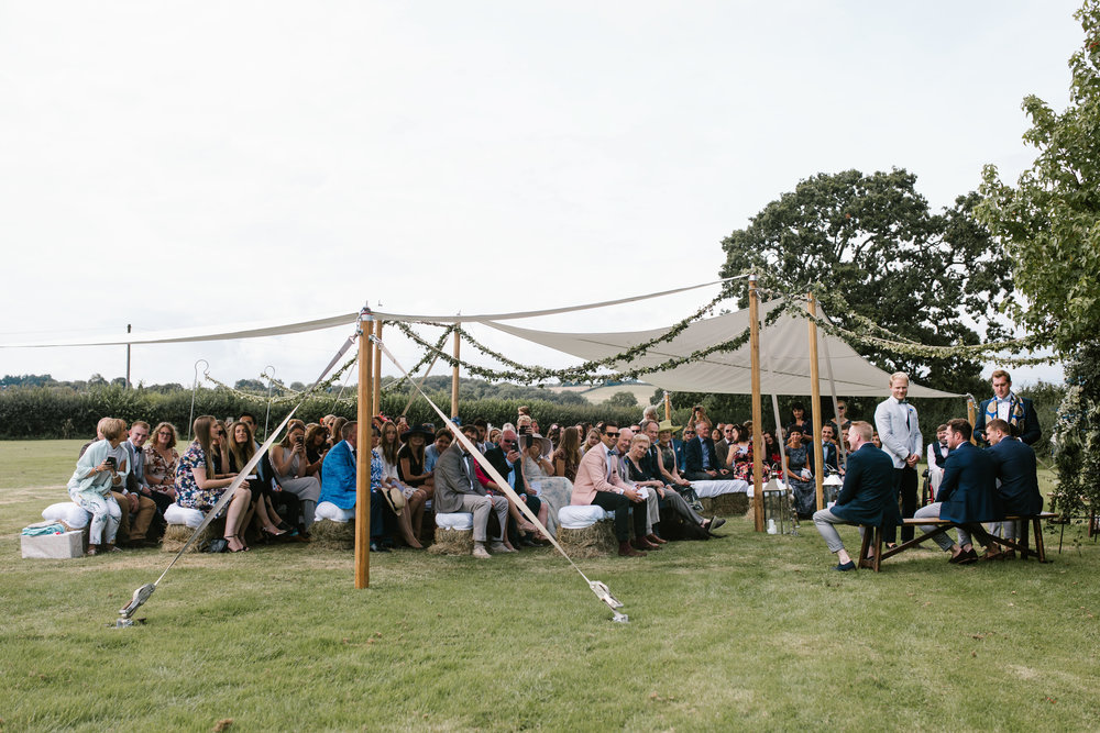 guest gather in the outdoor back garden wedding ceremony