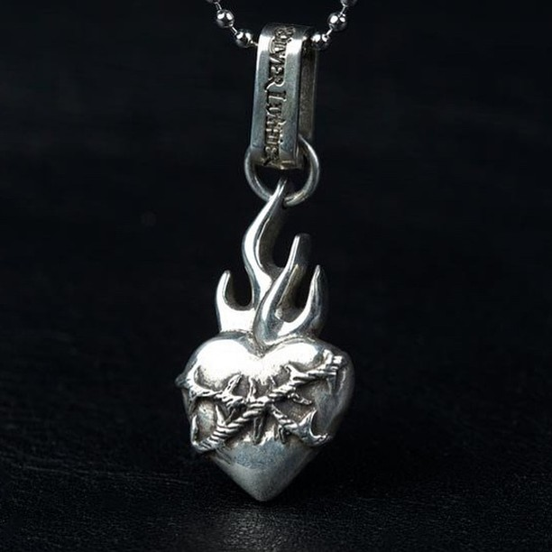 Flaming Heart by @silver_luthier available now for Valentine's Day… See website link in bio to purchase. Enter code VALENTINE for  20 percent discount. #valentines #jewelry #forsale #flamingheart #silver #custom #handcarved