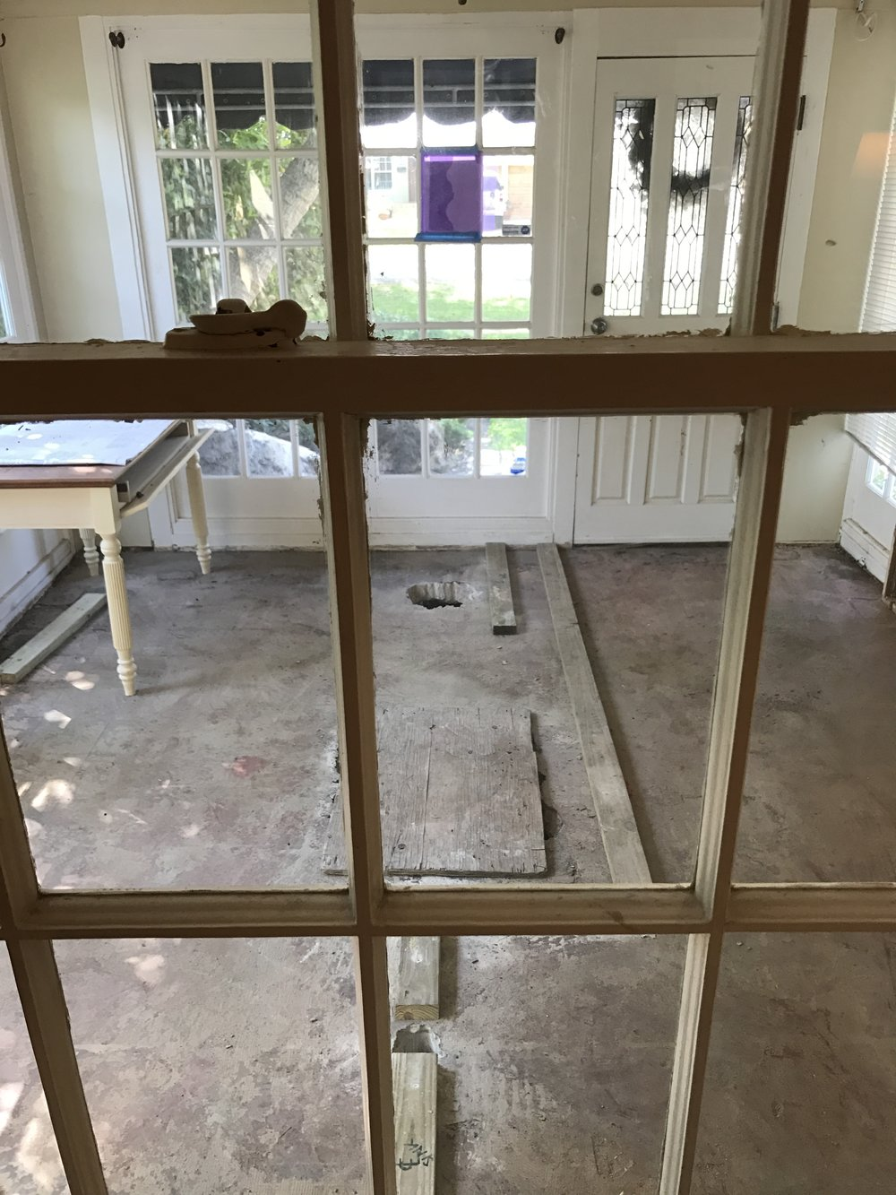 This is the sunroom space that we tuned into the master bathroom, master closet and entry way to the house.  The wood planks on the floor are the outline of the master bath for reference,,,