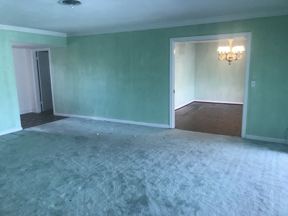This view is standing in the doorway of the master suite and looking into the formal living area and current dining room space. This wall will be coming out as well as the left wall of the dining room.