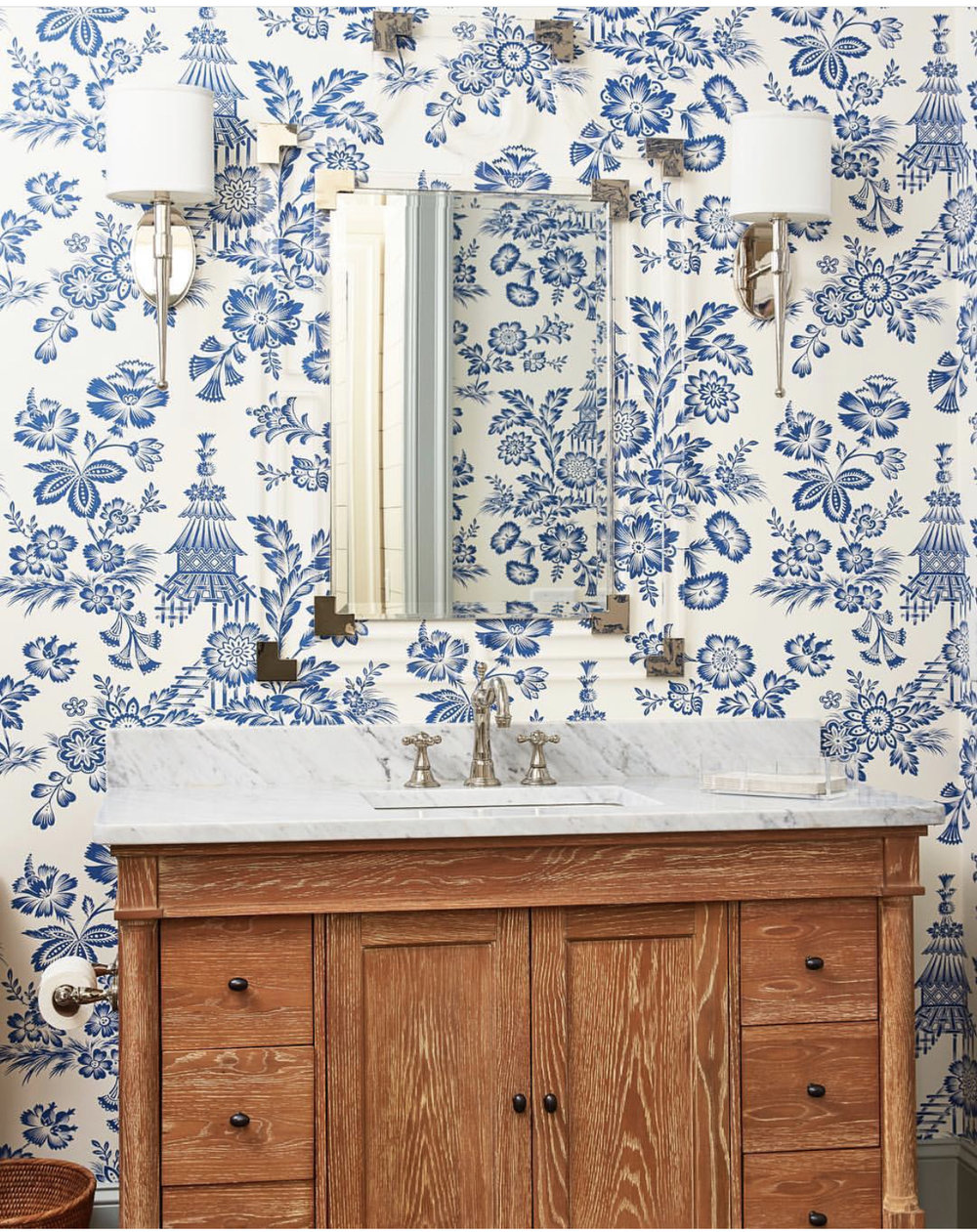 *half bath inspiration. That blue and white wall paper, lucite mirror, wood vanity and marble countertops SPEAKS to me.