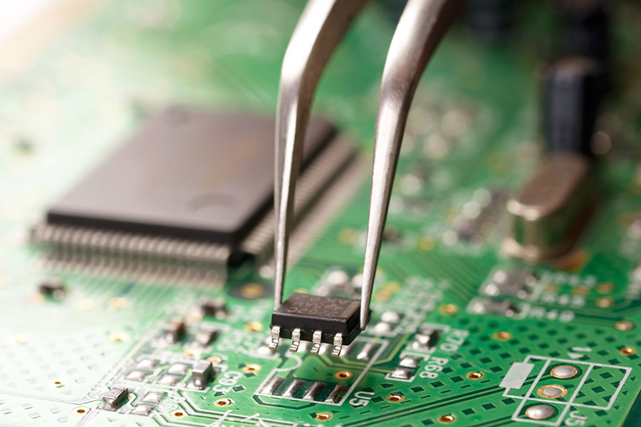 Jaycon PCB Assembly - Tweezers placing component on circuit board