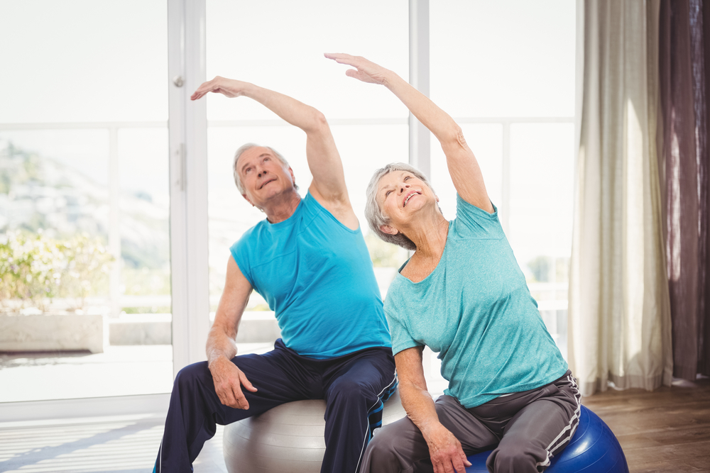 seniors performing stretching exercise at a retirement community in OKC