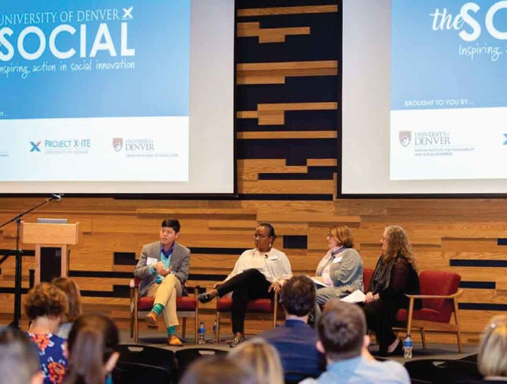"Michael Niyompong from Mental Heather Center of Denver, Dierdre Johnson from the Center for African American Health, and Helen Drexler from Delta Dental speak with Dean Amanda Moore McBride of DU's Graduate School of Social Work (GSSW) at ""The Social,"" an event co-sponsored by the Barton Institute, Project X-ITE and GSSW."