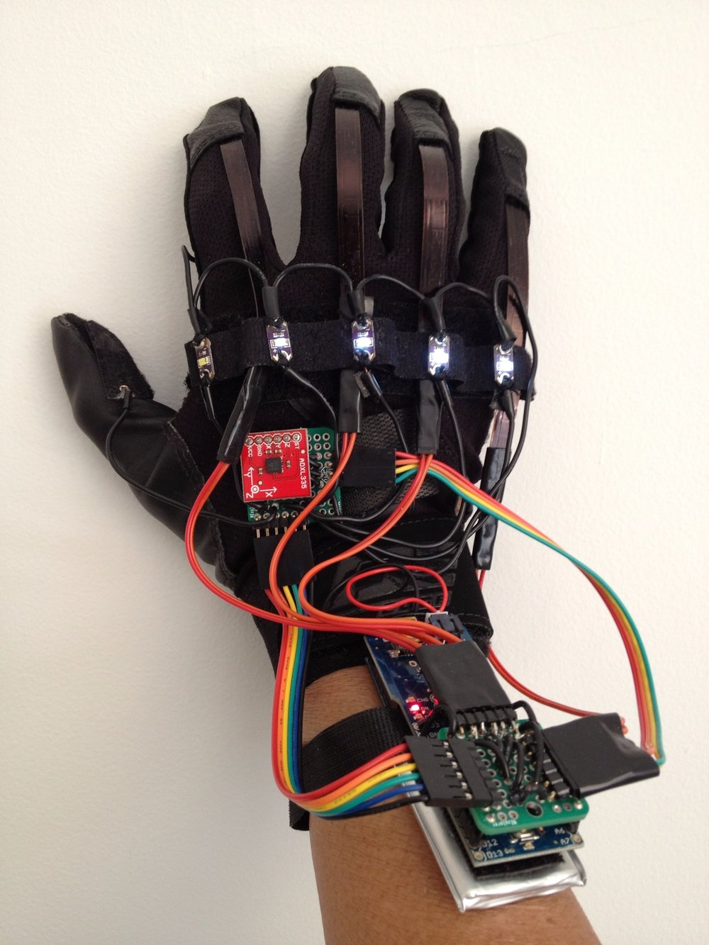 A W.A.V.E. Glove is a Wearable Audio & Vocal Exciter   WAVE Glove , designed in collaboration with  Takahiko Tsuchiya . Takahiko Tsuchiya earned his bachelor's degree in music from Berklee College in Boston and master's degree in music technology from Georgia Tech, where he continues as a doctoral student. His primary research interests are data sonification and analytics, including the development of web-based data-agnostic sonification frameworks, and encoding and decoding of data using musical structures.