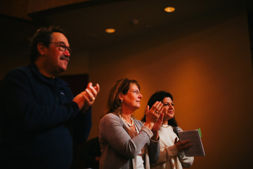 FULL HOUSE.  Rabbi Mark Schiftan, his wife, and their daughter, SarahRose, stand in the audience to applaud as the concert comes to a close.