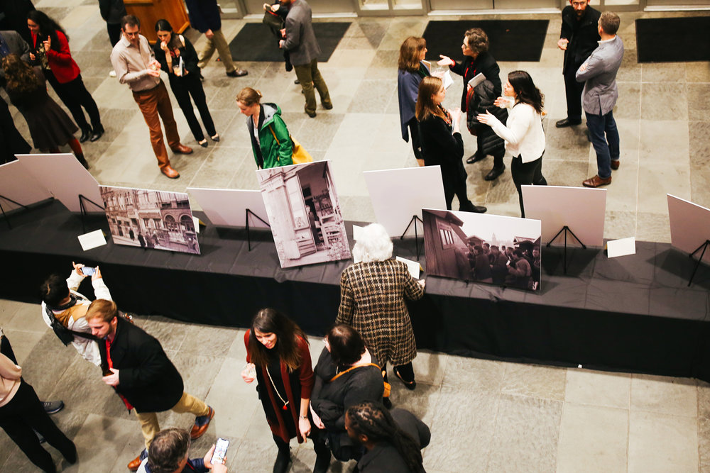 GUESTS IN THE GALLERY.  On display in the lobby at Vanderbilt was a photo exhibit to educate attendees on the historical relevance and context of what they were about to see.
