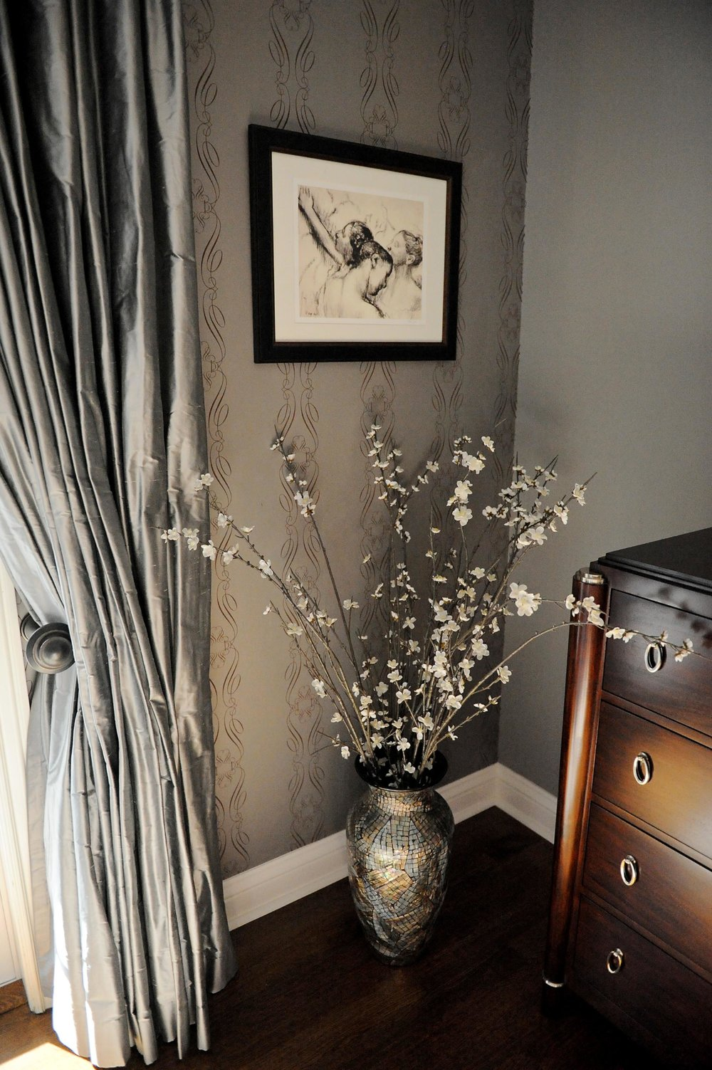 Elegant painting, flower vase beside and cabinet