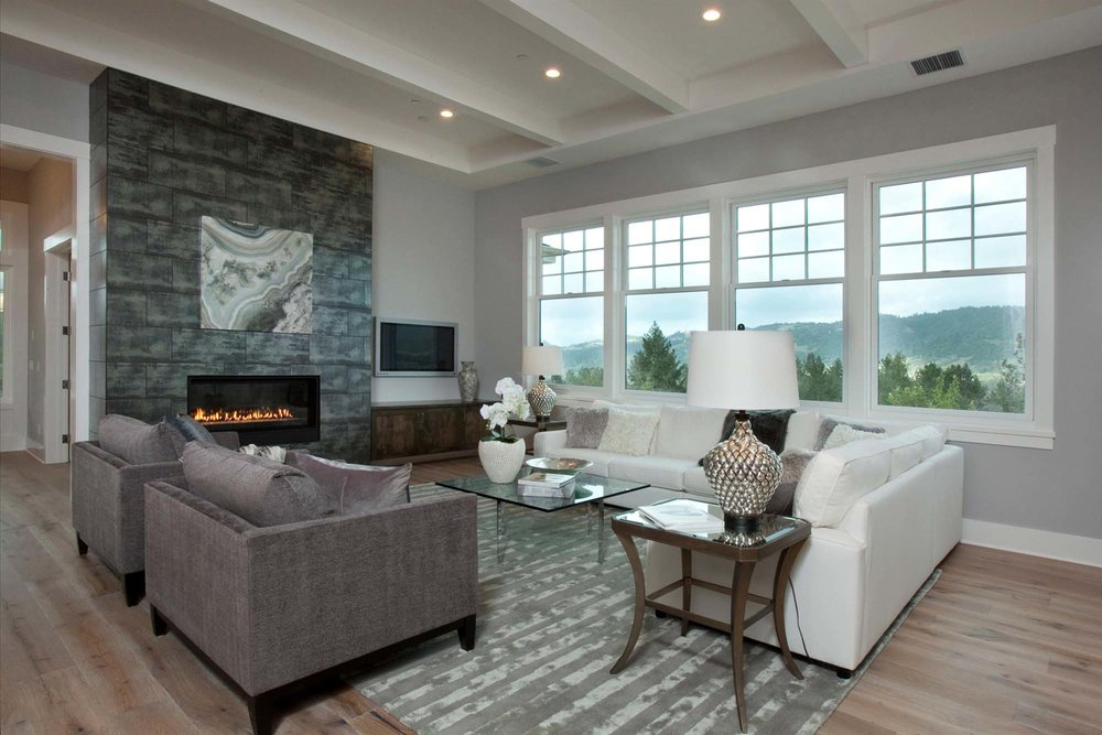Modern living room with chimney, White sofa and a mountain view window