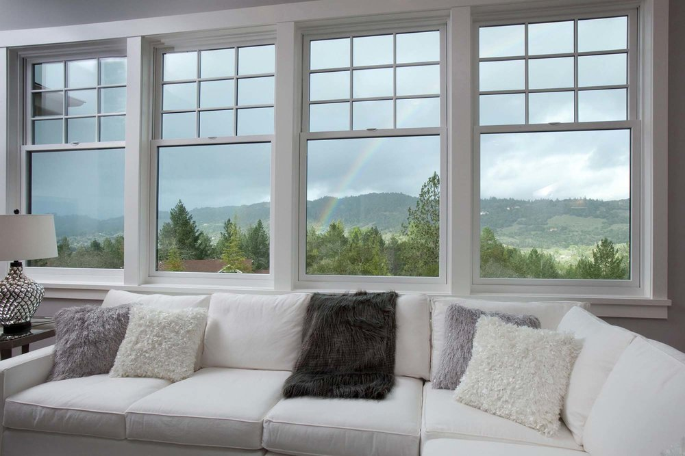 Living room with white sofa and mountain view window