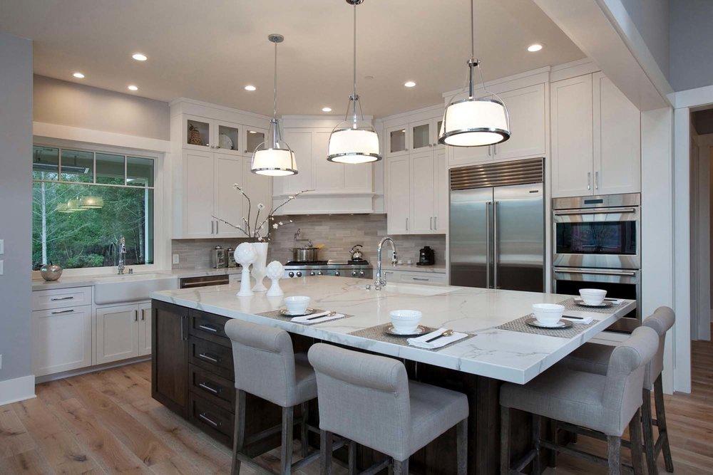 Stylish kitchen with chairs and kitchenware