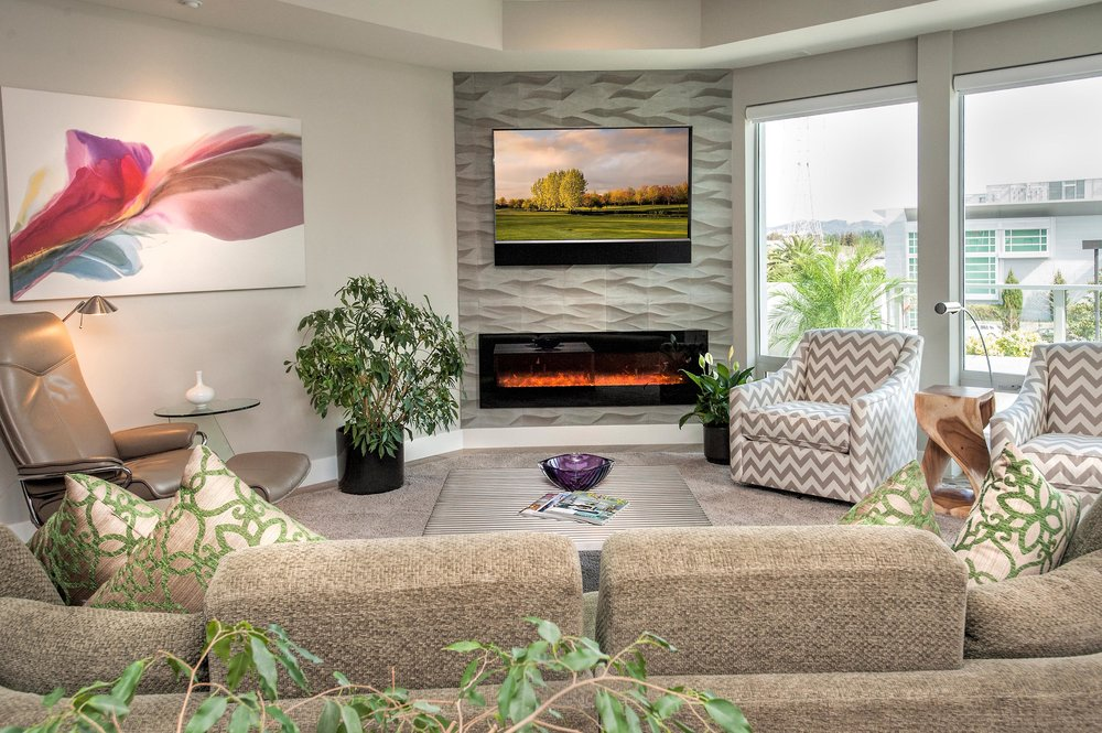 Living room with television and four flower pots
