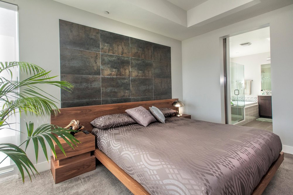 Contemporary bedroom with floor mattress and a lamp