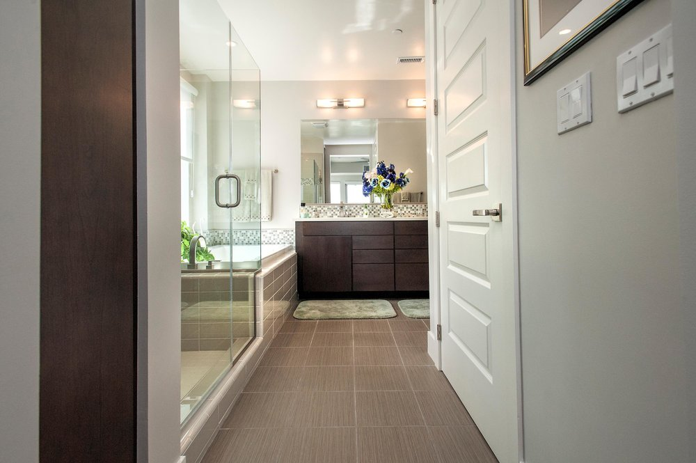Bathroom with tile flooring and mirror
