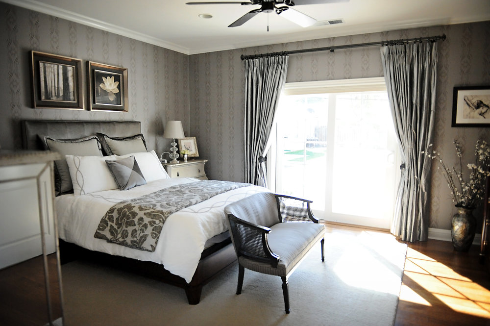 Master's bedroom with white and gray furnishing and a glass panel window