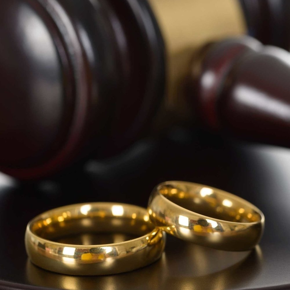 wedding-rings-and-wooden-gavel.jpg