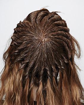 Etape 10   On applique un cuivré plus intense sur le dessus de la tête séparé en plusieurs quartiers d'orange.