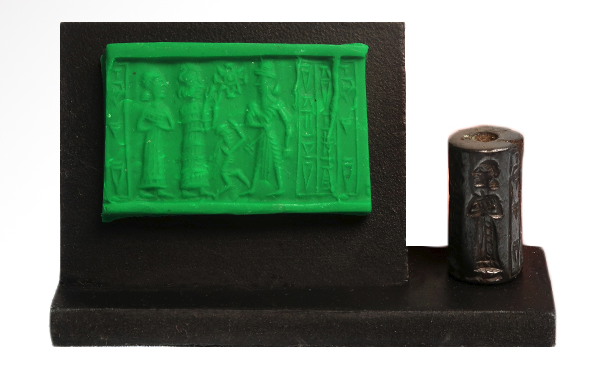 Sumerian cylinder seals, which tend to be around 1 inch in length. The one shown is 2.2 cm (7/8 inch) long and is a  cylinder seal with frieze depicting a standing robed figure in advancing pose facing a standing figure in flounced robe with hands raised, star above a small dancing figure, fourth robed figure to the rear, three columns of cuneiform text. It dates from Old Babylonian 20th - 18th Century B.C and is made of Hematite. The seal also contains text of cuneiform writing (credit: K. F. Long, from private collection of the same).