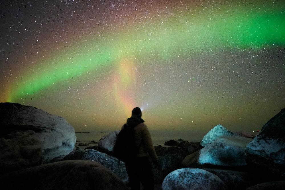 Self portrait on a beach in Lofoten, Norway watching the Aurora Borealis intense light show.