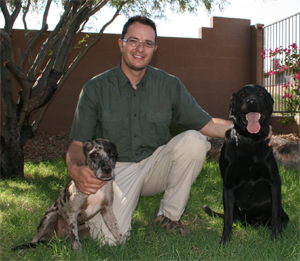 Keith Coddington with two of his bed bug dogs