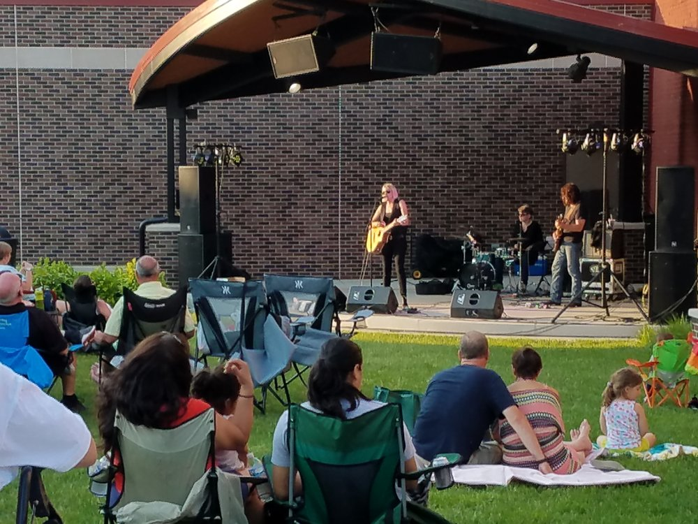 Photo Caption: Sean Wiggins and band perform at the Sheridan Plaza stage in downtown Whiting.