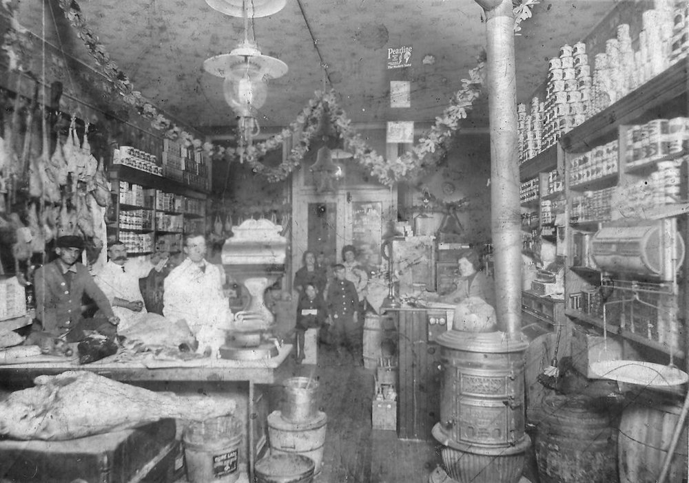 The Bartlett & Lee grocery store was on New York Avenue between 119th Street and Fischrupp Avenue, on the east side of New York. This photo from the early 1900s shows the interior of the store. Those pictured are Frank Bartlett, Ernie Howard, Joe Ann Spansburg, and Mrs. Frank Bartlett.