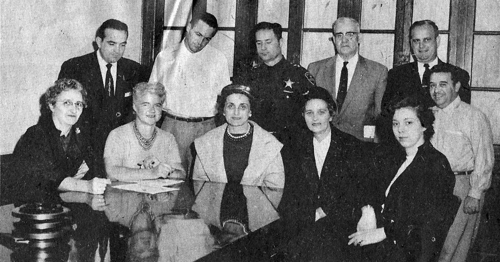 A committee responsible for the Whiting Halloween Parade, from the late 1950s or early 1960s. In the front row, left to right: Mrs. W.C. Hubbard, Laura Siebert, Mary E. Bercik, Mrs. Frank Phillippe, Mary McCord. Standing in the back row, left to right: John Petro, Fred Rader, Whiting Police Capt. Mike Skavara, John Glasheen of the Whiting Moose, Fire Chief John John J. Kostolnik, and Andy Yanas of the Community Center.