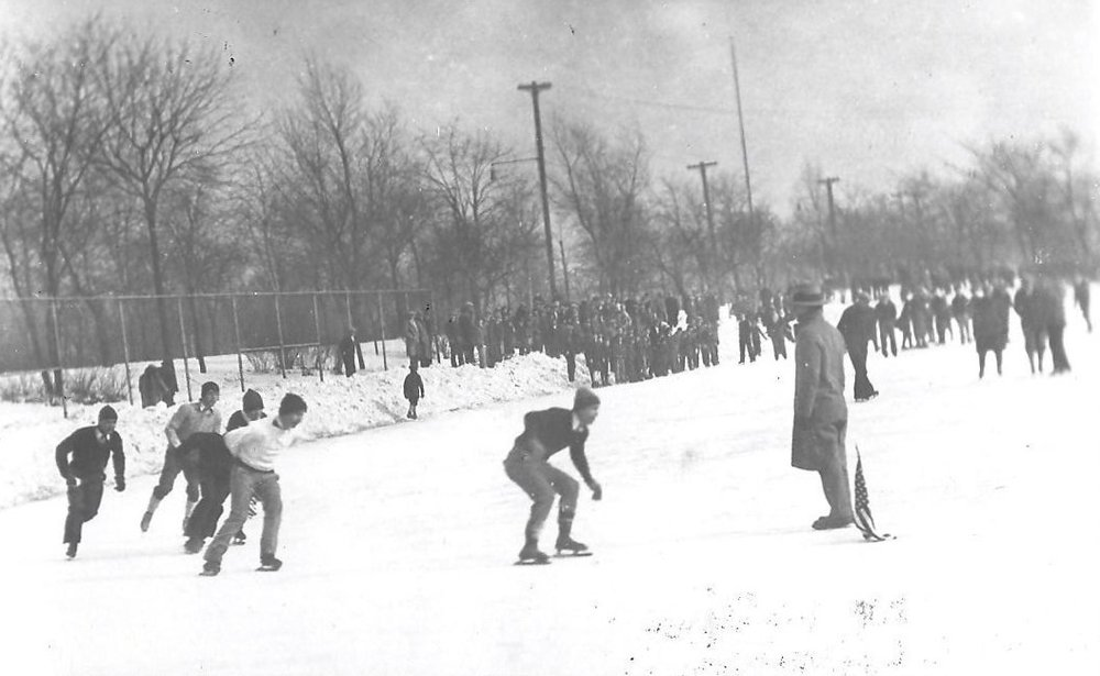 Skaters round one of the turns in an Ice Carnival race on the Whiting Park lagoon in the 1920s.