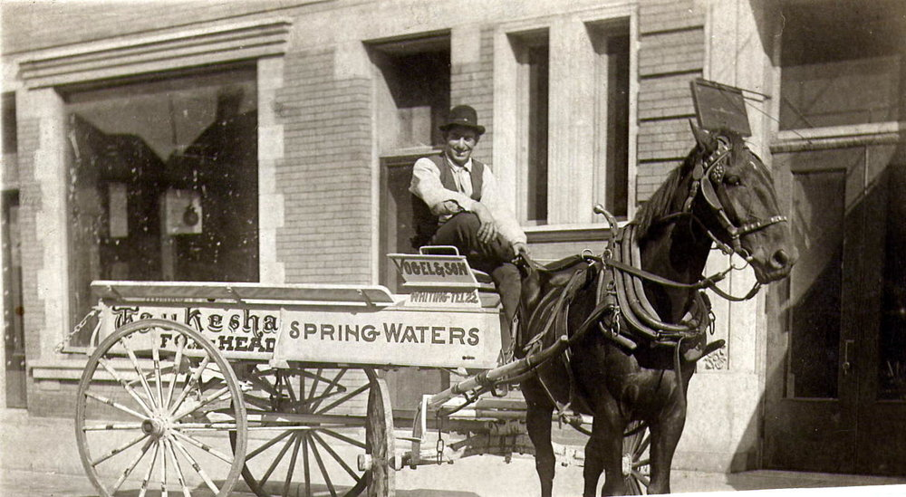 Fred Vogel driving his Vogel & Son beer delivery wagon.