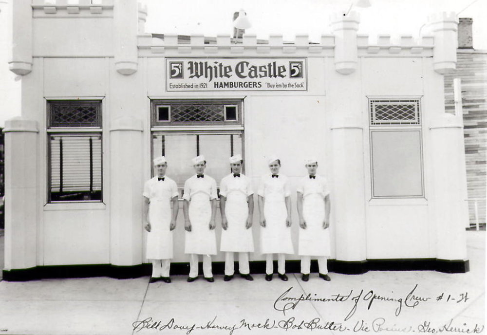 White Castle came to Whiting in 1935. This is the crew that worked in the Whiting White Castle on its first day. They are identified as Bill Davy, Harvey Mock, Bob Butler, Vic Porius, and George Herrick.