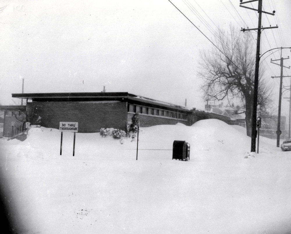 Snow drifts piled up nearly to the roof of the Whiting Clinic on Indianapolis Boulevard, which Dr. Donald H. Rudser kept open to deal with any local emergencies during and after the blizzard.