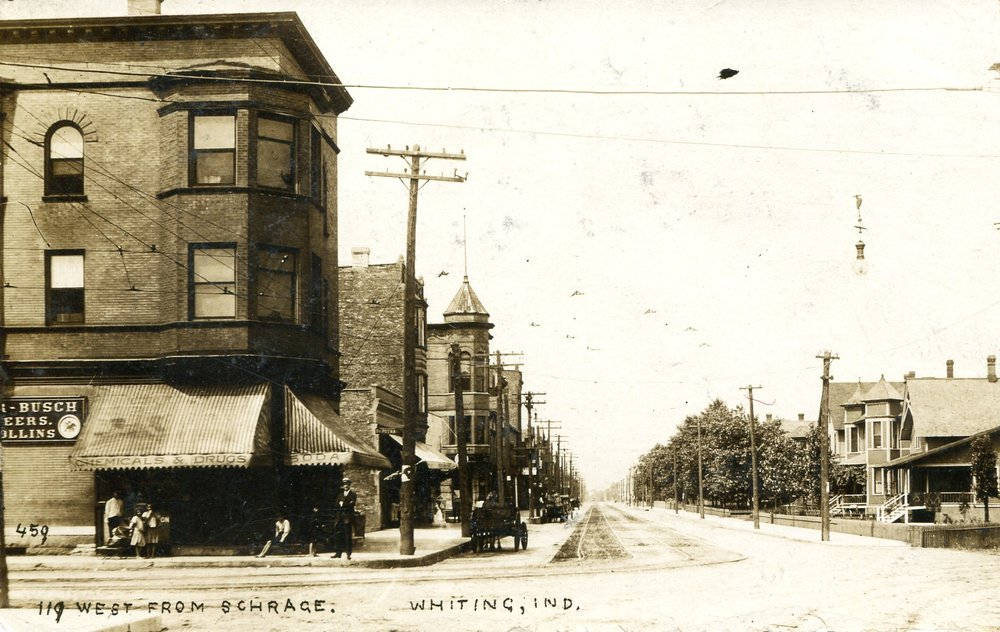 A view of 119th Street looking west from Schrage Avenue, probably in the early 1900s. The building on the left housed a pharmacy on the ground floor. Note the housing on the north side of 119th, in the vicinity of what is today the Whiting Baptist Church (1547 119th Street).