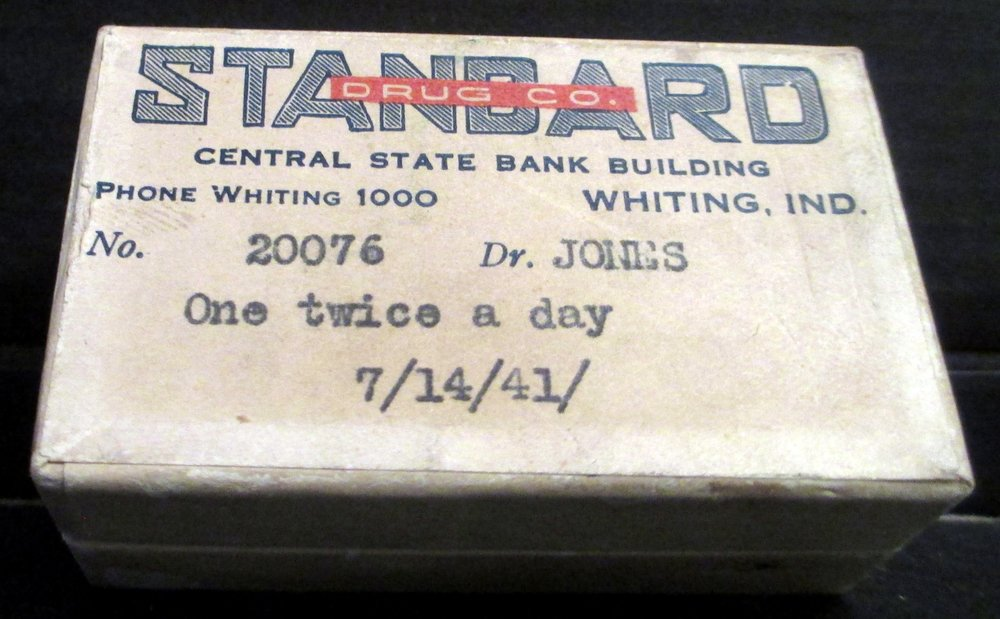 The Standard Drug Company was a long-time occupant of the Central State Bank Building. This is a pill box from the pharmacy from 1941.