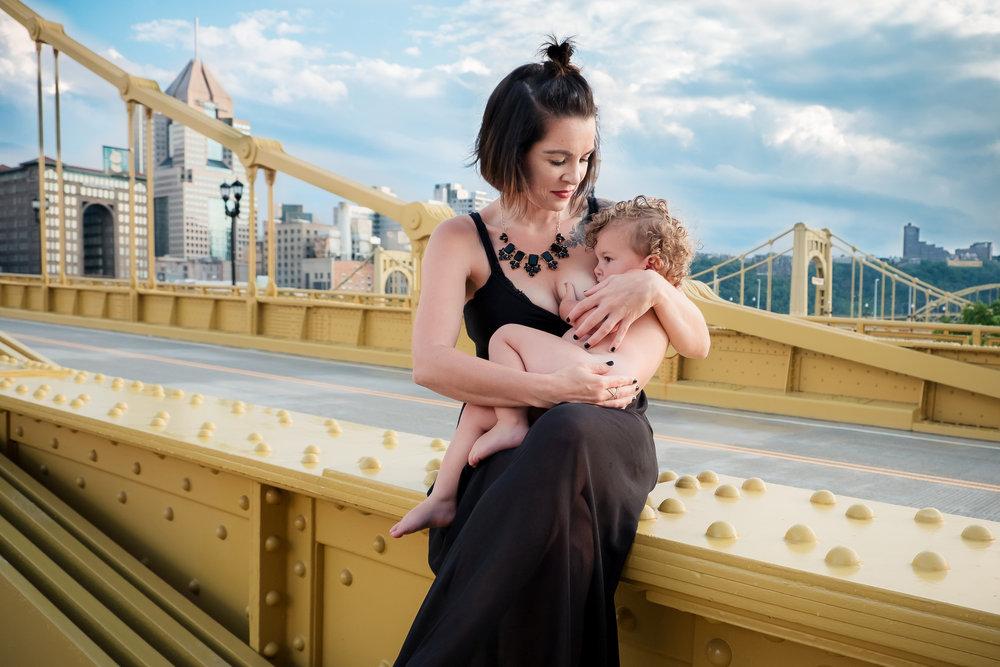 Breastfeeding mother on Andy Warhol Bridge Pittsburgh