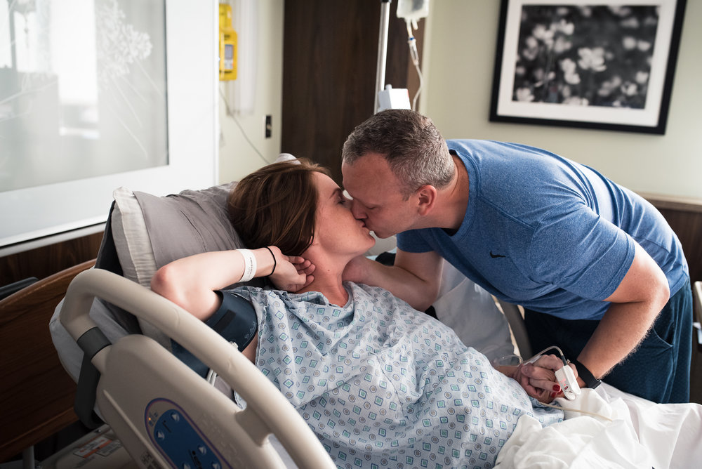 couple kissing in labor