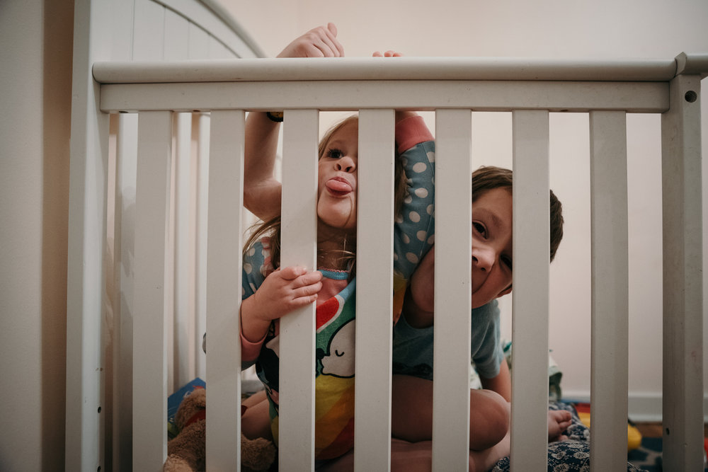 Children playing in crib