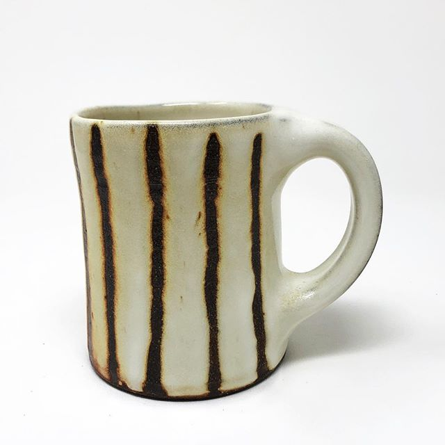 I listed 8 mugs and 8 tumblers by @jgeciglass on my website. Go take a look- link in profile.  #mugshotmonday #courtneymartinpottery #womenwhowoodfire #ceramics #mugs #handmade #potterysale