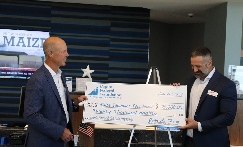 Capitol Federal® CEO, John Dicus, presents the check to Maize Education Foundation Executive Director, Travis Bloom.
