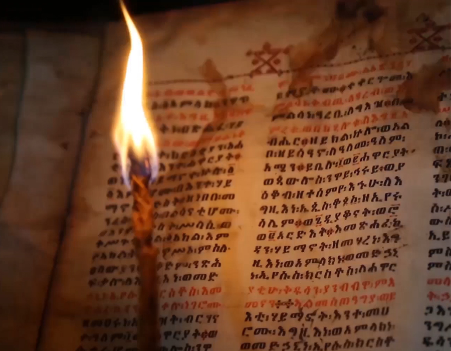 One of the amazing parchments filmed for the series are read aloud by Ethiopian Orthodox monks, using candlelight. The priests are trained from youth to care for and read the texts, by candlelight, and have passed down these hand-written copies of the Bible in Ge'ez (and more recently Amharic) for several hundred years longer than the English version has existed.