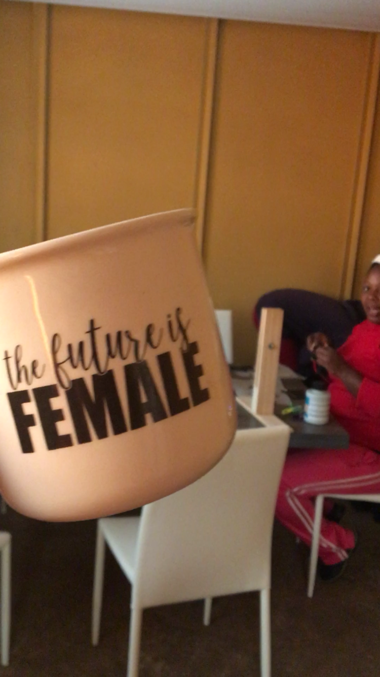 feminist mug and Nabuhle working hard in the background
