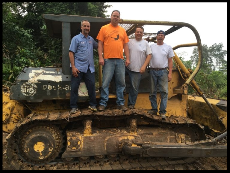 Our crew of Jungle destroyers: Chase, Tom, Steve, and Mike. And our bulldozer- about $1000/day!