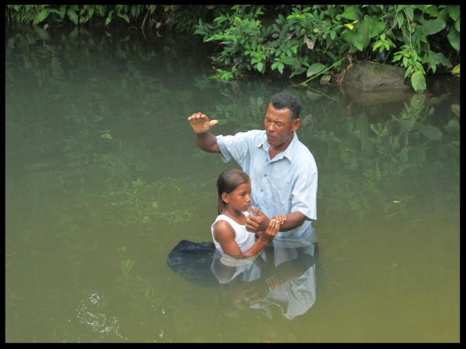 One of the girls being baptized in the village of Suhi