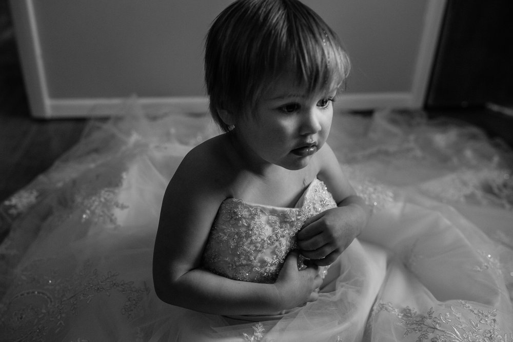 Girl in mom's wedding dress.jpg