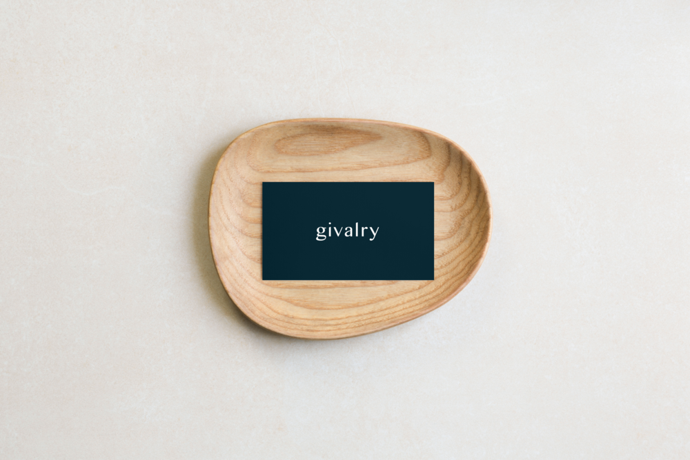 Givalry business cards in a wooden bowl