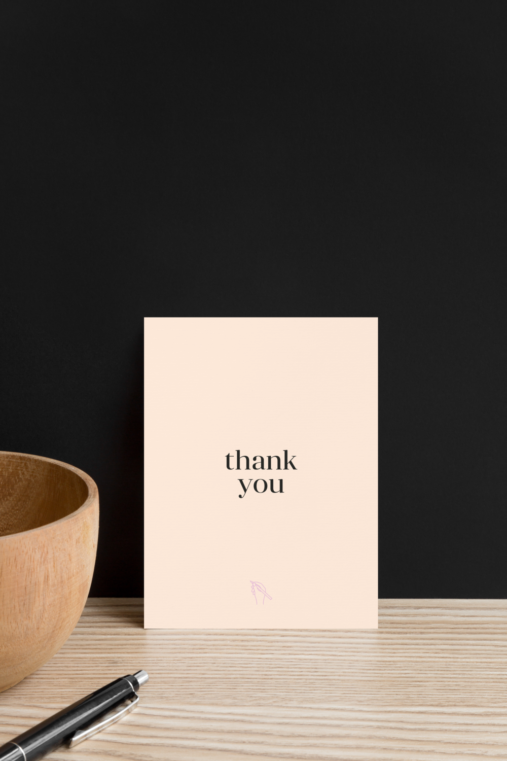 Peach thank you card with line drawing icon of a hand for Zafira Rajan designed by Salt Design Co.